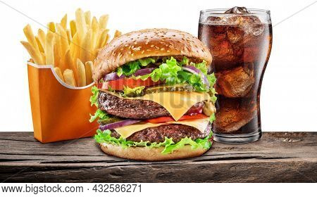 Delicious cheeseburger with cola and potato fries on the white background. Fast food concept. File contains clipping path.