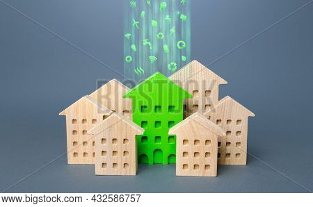 Green Building Stands Out Among The Houses. Renovation And Environmental Improvement Of Old Building