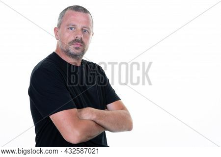 Handsome Serious Man Dressed In Casual Black Shirt Aside Copy Space Isolated On White Background