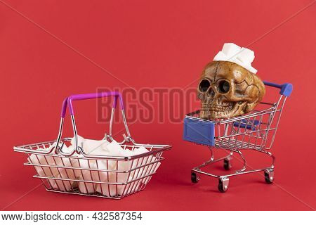 A Basket Filled With Refined Sugar Cubes With A Human Skull On A Red Background. Copy Space.