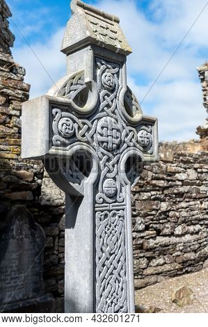 Timoleague, Ireland- July 15, 2021: Stone Carved Irish Cross In The Ruins Of An Abbey In Ireland