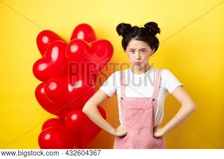 Valentines Day And Relationship Concept. Disappointed Asian Girlfriend Sulking, Looking Offended At