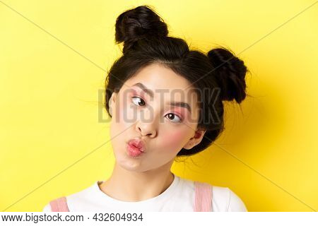 Close Up Portrait Of Funny Asian Teen Girl With Glamour Makeup And Hairstyle, Squinting Eyes And Puc