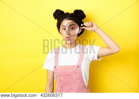 Silly Glamour Lady With Bright Makeup, Look Through Magnifying Glass And Pouting, She Is Watching Yo