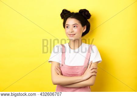 Smiling Beautiful Asian Girl With Glamour Makeup, Looking Aside At Logo With Happy Face, Standing In