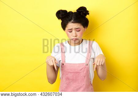 Sad Miserable Girl With Glamour Bright Makeup, Looking And Pointing Down Upset, Showing Bad Thing, S