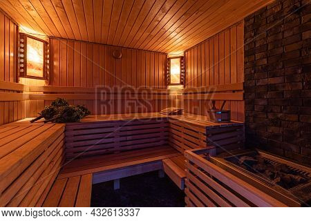 Russian Bath Made Of Wood With Bath Brooms And Couches