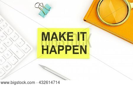 Sticker With The Text Make It Happen On White Background, Near Calculator And Notebook