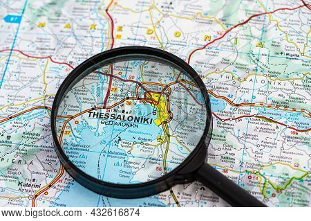 Map Of Thessaloniki In Greece Through Magnifying Glass, Concept Of Planning The Travel Itinerary