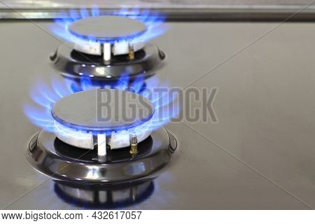 Gas Cooker With Burning Flames Of Methane Or Propane Gas. Modern Kitchen Stove Cook With Blue Flames