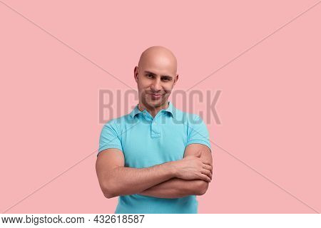 Skeptical Bald Homosexual Man With Bristle Crosses Hands Over Chest, Does Not Believe Information, M