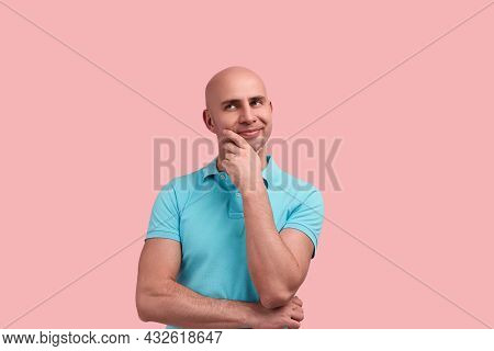 Pleased Bald Homosexual Man With Bristle Is Dreaming, Rolls Eyes In Fantasies, Calculates Savings Or