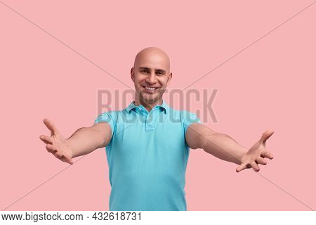 Come And Hug Me. Happy Smiling Bald Homosexual Man With Bristle Is Meeting Friend, Reaching Out Hand