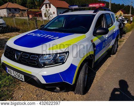 Leliceni, Romania- 11 September 2021: New Dacia Duster Police Car Near Roadside.