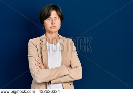 Young caucasian woman with arms crossed gesture skeptic and nervous, frowning upset because of problem. negative person.