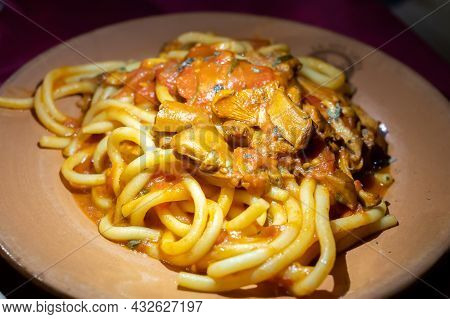 Italian Vegetarian Dish Macaroni With Golden Chanterelles Mushrooms And Tomatoes