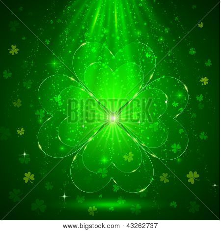 Green glass clover in the magic light background