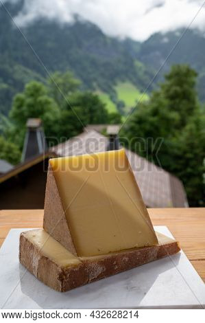 Cheese Collection, French Cow Cheese Comte, Beaufort, Abondance And French Mountains Village In Haut