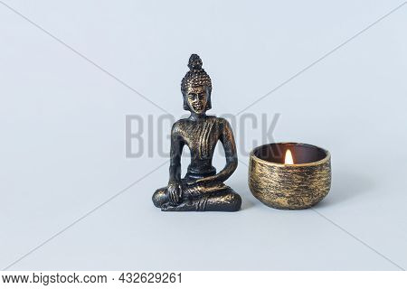 Buddha Statue On Altar With Burning Candle. Meditation, Buddhism And Enlightenment Concept