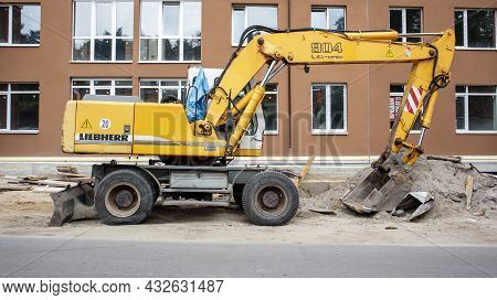 Mobile Crane Loader Of Yellow Color On The Background Of A Building Under Construction. Internationa