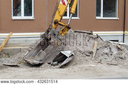 Mobile Crane Loader Of Yellow Color On The Background Of A Building Under Construction. German-swiss