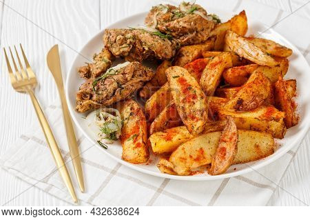 Grilled Pork Shoulder Steaks With Roasted Potato Wedges Seasoning With Paprika And Dill On A White P