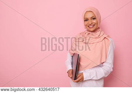 Gorgeous Muslim Woman In Stylish Traditional Religious Outfit With Covered Head In Pink Hijab Smilin