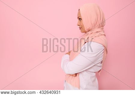 Confident Close-up Portrait Of Arab Muslim Confident Woman With Attractive Gaze , Wearing A Pink Hij