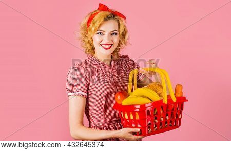 Smiling Woman With Shopping Basket With Groceries In Supermarket. Buying Spree.