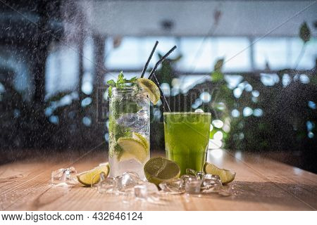 Mojito With Mint, Lime And Ice In Glass And Green Tarkhun Tarragon Drink In Cafe