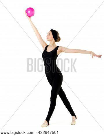 Slim Girl In Sportswear Doing Gymnastics With Ball. Full Length Portrait Of Graceful Teenage Girl In