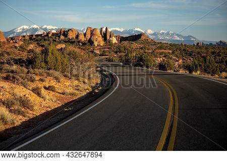 Road Curves Toward The Sand Dune Arch Area Of Arches National Park