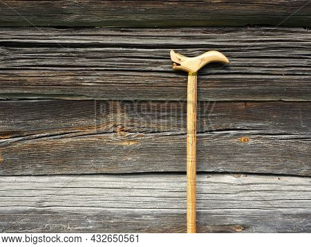 Wooden Walking Stick. Old Wooden Wall And Cane. Care For The Elderly