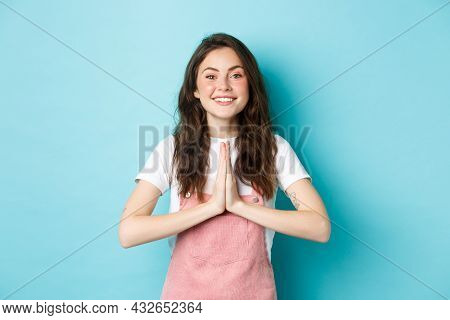 Thank You. Smiling Cute Girl Showing Namaste, Gratitude Gesture, Asking For Help Or Favour, Smiling