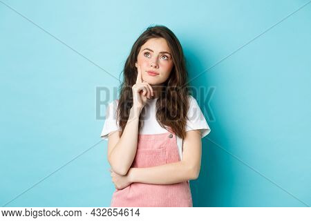 Image Of Thoughtful Cute Glamour Girl With Make Up, Looking At Upper Left Corner Pensive, Thinking O