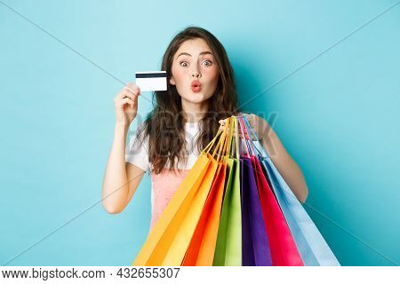 Glamour Girl Showing Plastic Credit Card And Shopping Bags, Pucker Lips For Kiss, Standing Happy Aga