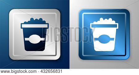 White Popcorn In Cardboard Box Icon Isolated On Blue And Grey Background. Popcorn Bucket Box. Silver