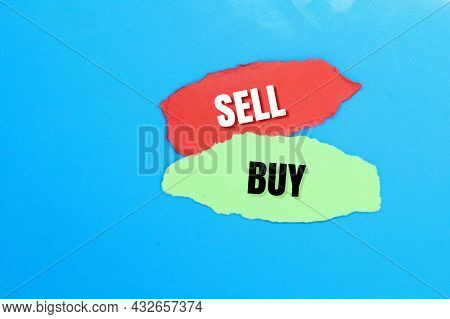 Red And Green Paper Torn With The Words Sell And Buy. The Concept Of Selling And Buying