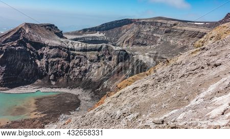 The Caldera Of An Active Volcano. The Structure Of The Steep Slopes Of The Crater Is Visible. At The