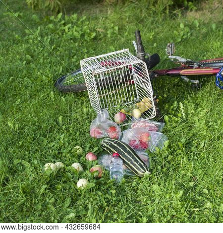 A Bicycle Accident With A Food Fell Out Of On A Basket