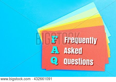 Colored Paper With The Words Frequently Asked Questions. Concept Question