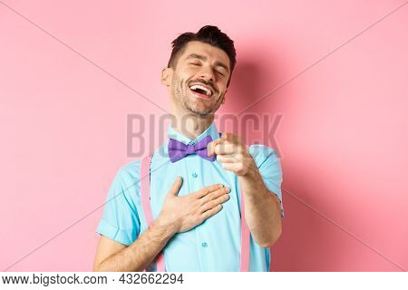 Handsome Guy In Bow-tie Pointing Finger At Camera And Laughing On Something Funny, Checking Out Hila