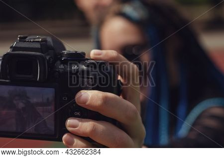 A Young Woman And A Man Taking Selfies With A Dslr Camera. Heterosexual Couple In Front Of The Runni