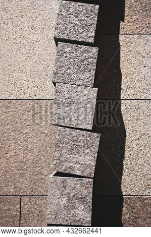 Granite Paving Stones Of Brown Color For Laying And Lining The Pedestrian Sidewalk Lies On The Surfa