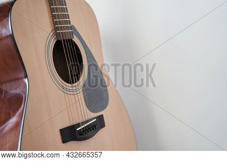 Soundboard Of An Acoustic Guitar Close Up On A White Background