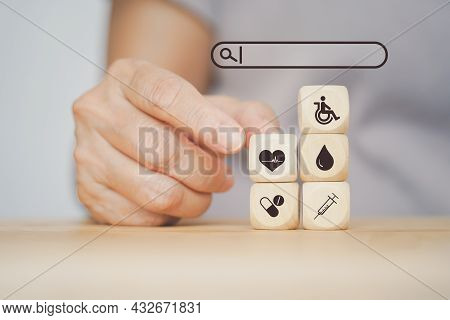 Senior Human's Hand Choose Blood Icon And Other Health And Medical Sign On Wood With Search Bar For