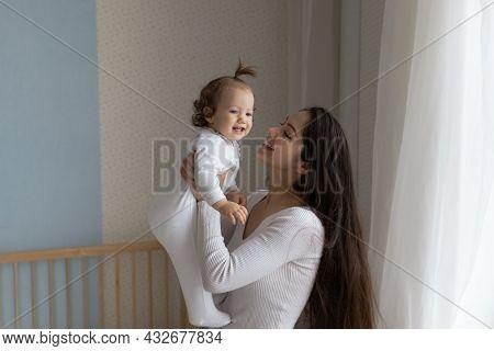 Happy New Mom Enjoying Motherhood, Maternity Leave, Holding