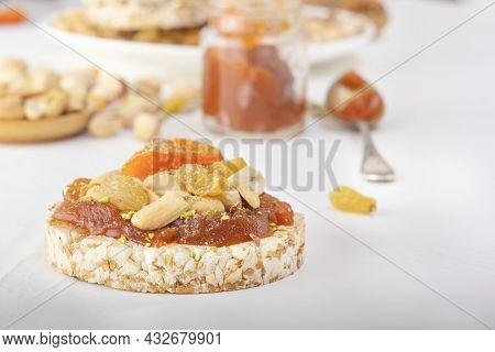 Puffed Exploded Wheat Grains With Peanuts And Dried Apricots On A Thin Layer Of Apricot Jam On A Bac