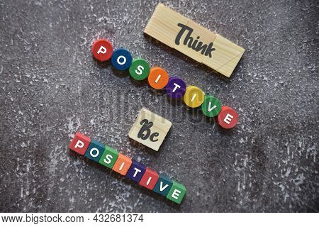 Think Positive Be Positive Wording On The Wooden Blocks Lifestyle Concept.