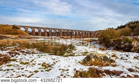 The Big Water Of Fleet Surrounded By Snow In Winter, With The Railway Viaduct In The Background, Dum
